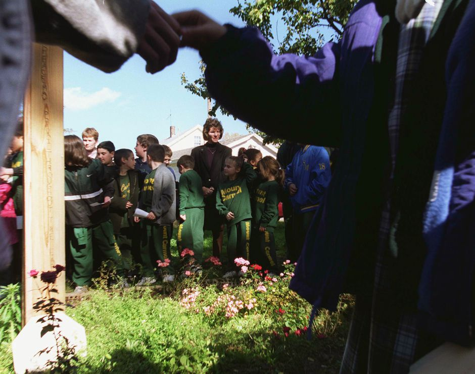 Students at Our Lady of Mount Carmel School shook hands as they pledged to act peacfully Oct. 25, 1999. The ceremony took place at the Peace Garden they planted.