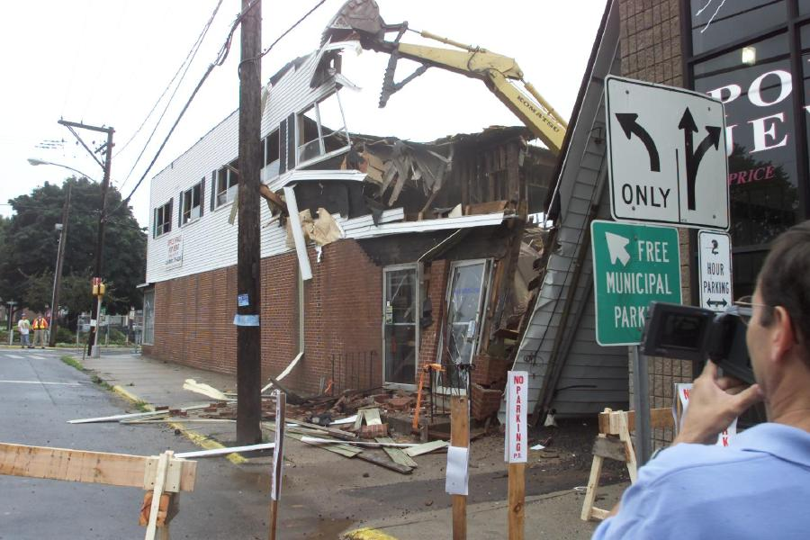 Edward Simpson of Format Company, records a video of the demolition of the Oxley building at the corner of Main and Center Streets in Southington, the building was torn down Tuesday morning to make way for a new three story building, Aug. 1, 2000. Demolition was performed by Lauretti Construction of Forestville.