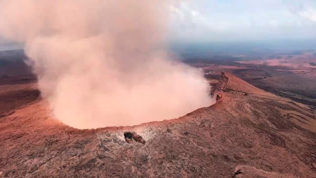 In this Saturday, May 5, 2018 photo provided by U.S. Rep. Tulsi Gabbard, who is on active duty Hawaii National Guard deployment, ash from the Puu Oo vent on Kilauea volcano rises into the air, near Pahoa, Hawaii. Hawaii