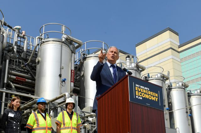 Democratic Presidential candidate Washington Gov. Jay Inslee, right, speaks during an event at the Blue Plains Advanced Wastewater Treatment Plant in Washington, Thursday, May 16, 2019, during an event where he unveiled part of his plan to defeat climate change. (AP Photo/Susan Walsh)