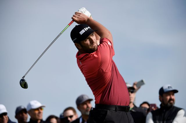 John Rahm hits his tee shot on the second hole of the South Course at Torrey Pines Golf Course during the second round of the Farmers Insurance Open on Friday in San Diego, California. He shot a 65 on Saturday to take a one-shot lead. Denis Poroy, Associated Press