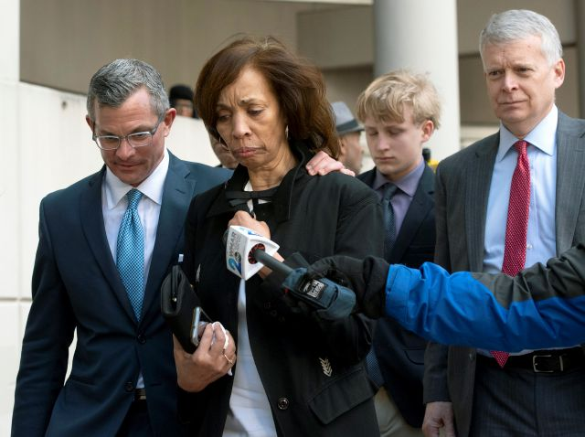 Former Baltimore mayor Catherine Pugh, second from left, and her attorney Steven Silverman, left, leave a sentencing hearing at U.S. District Court in Baltimore on Thursday, Feb. 27, 2020. Pugh was sentenced to three years in federal prison for arranging fraudulent sales of her self-published children