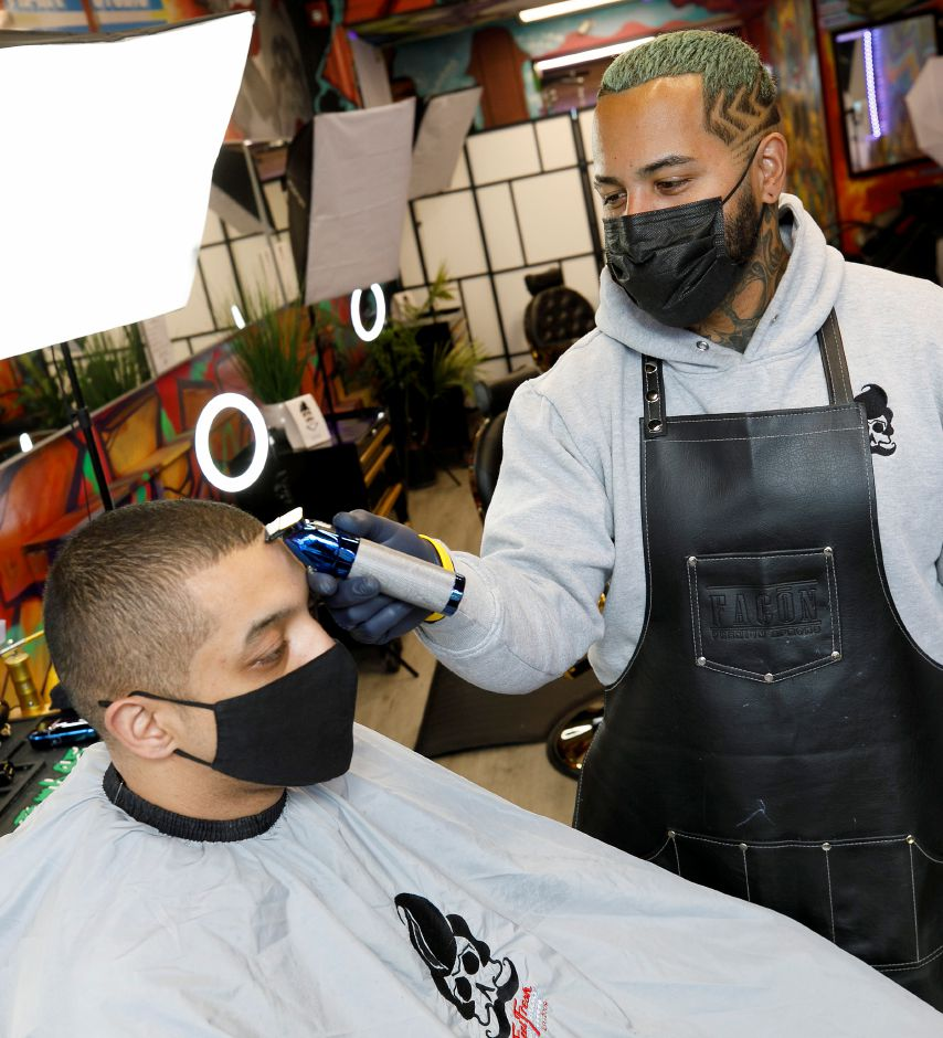 David Ortiz, owner of Feel Fresh Hair Studio, gives a trim to brother Armando Ortiz, of Meriden, at the 65 W. Main St. barbershop in Meriden, Thurs., Mar. 18, 2021. Dave Zajac, Record-Journal