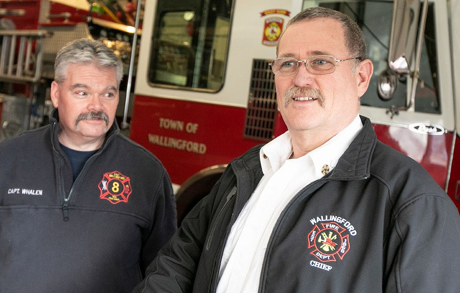 Fire Chief Richard Heidgerd, right, and Capt. Tim Whalen, share memories of firefighter Mike Cyganik at East Wallingford Volunteer Fire Department Station 8, Tues., Feb. 26, 2019. Cyganik died Thursday at the Smilow Cancer Hospital after a battle with pancreatic cancer. He was 55. Dave Zajac, Record-Journal