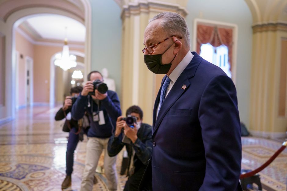 FILE - In this Feb. 12, 2021, file photo Senate Majority Leader Chuck Schumer, D-N.Y., returns to the chamber as the defense finishes arguments in the impeachment trial of former President Donald Trump, in Washington.. (AP Photo/J. Scott Applewhite, File)