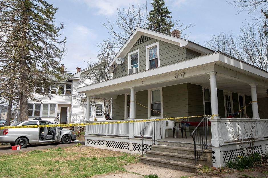 Meriden police investigate the scene of a shooting at 57 South First St., Fri., Apr. 19, 2019. The early Friday morning shooting resulted in one man being taken to an area hospital. Dave Zajac, Record-Journal