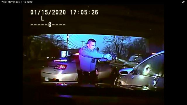 This Jan. 15, 2020, still image from dashboard camera video released by the Connecticut State Police shows Trooper Brian North, left, after he discharged his weapon beside vehicle stopped in West Haven, Conn. North fatally shot Mubarak Soulemane following a high-speed chase along Interstate 95 after Soulemane,19, had carjacked the vehicle in Norwalk, Conn. Clergy and relatives of Soulemane have called for the trooper be sent home on suspension and are asking for more de-escalation...