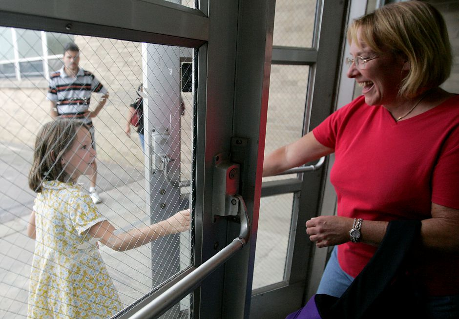 Record Journal Photo 8.28.08 - Jody Benton smiles while her daughter, Kylie Benton, a 2nd grade student from Plantsville School leaves classes at North Center School in Southington Thursday afternoon, the first day of classes in Southington.