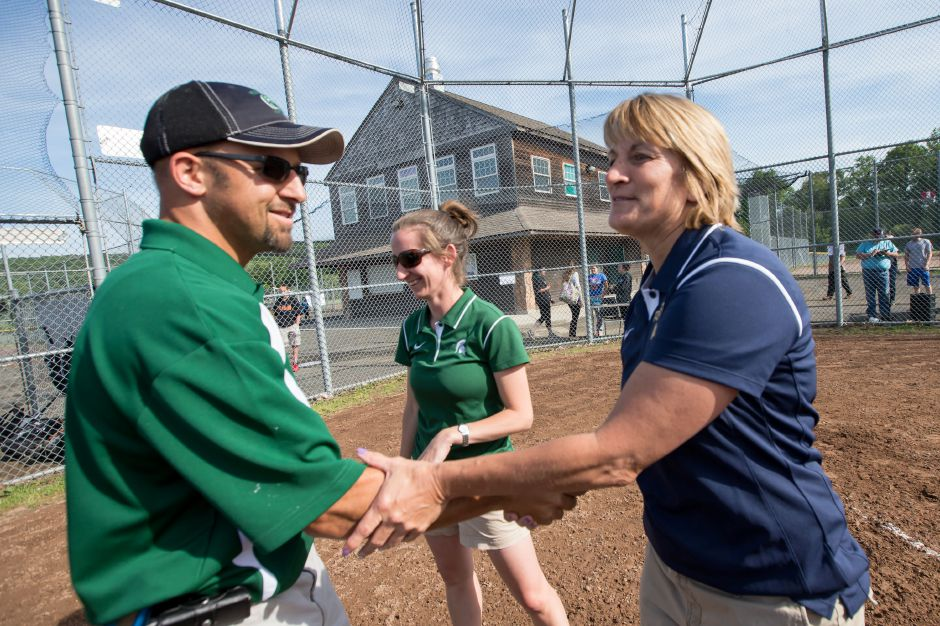"Maloney softball coach Scott Aresco, seen here greeting Platt's Trish Wodatch, was in on the CIAC's teleconference Wednesday that determined a wait-and-see approach would be taken regarding the coronavirus and 2020 spring scholastic season. When Aresco met with his players to announce the season wasn't being canceled, they erupted in joy. ""That really made my day,"" Aresco said. ""It showed how much they cared about playing and being together. That was a moment I will never forget."" 