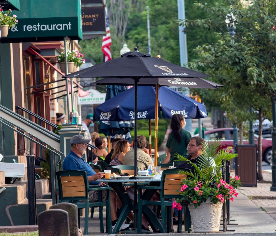 Customers enjoy their dinner at Archie Morre's outdoor seating along North Main St. in Wallingford on Thursday, July 23, 2020. Aaron Flaum, Record-Journal