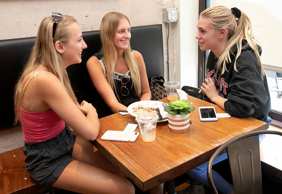 Left to right, Kayla Coppola, 20, Rachel Baldick, 19, and Allie Hair, 20, of Southington, share smiles at the new Southington Coffee House, 51 N. Main St. in Southington, Thurs., Aug. 15, 2019. Dave Zajac, Record-Journal