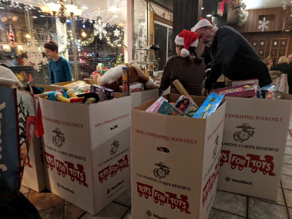 Volunteers gather toys collected during Thursday night