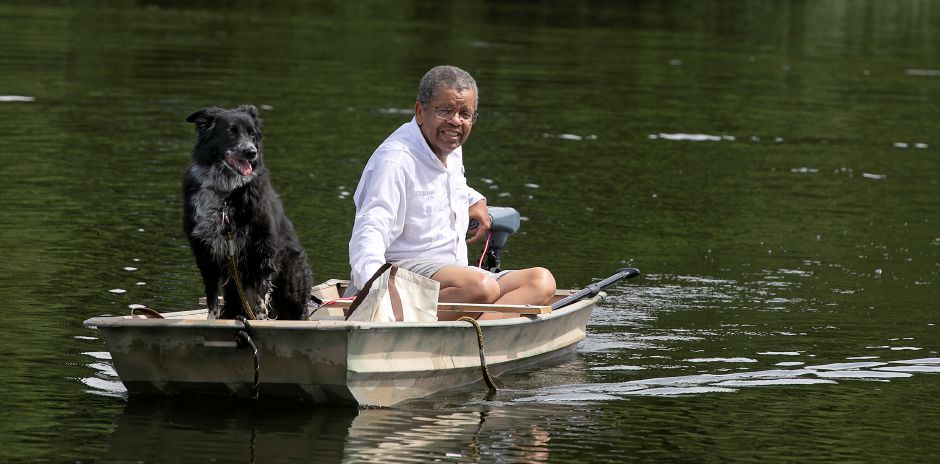 Above and below, Alan Kendrix, 72, of North Haven, and his border collie Bear patrol Mixville Pond for geese at Mixville Park in Cheshire Thursday. Kendrix is a licensed nuisance wildlife operator who  keeps geese away from Mixville Pond. Photos by Dave Zajac, Record-Journal