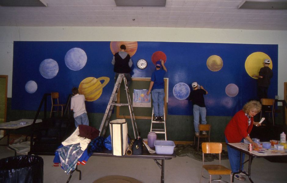 RJ file photo - Platt students help out at John Barry School by painting a mural that will be used to encourage reading, Jan. 27, 1994.