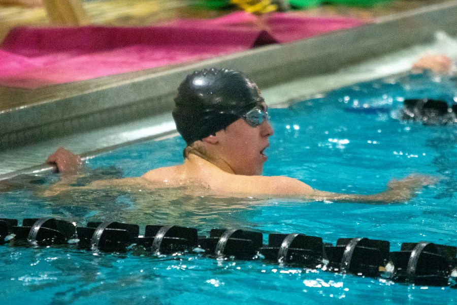 Sheehan's Aaron Gamble looks back for his time after finishing second in the 50-yard freestyle during Wednesday's rivalry meet against Lyman Hall/Coginchaug at Sheehan. Aaron Flaum, Record-Journal