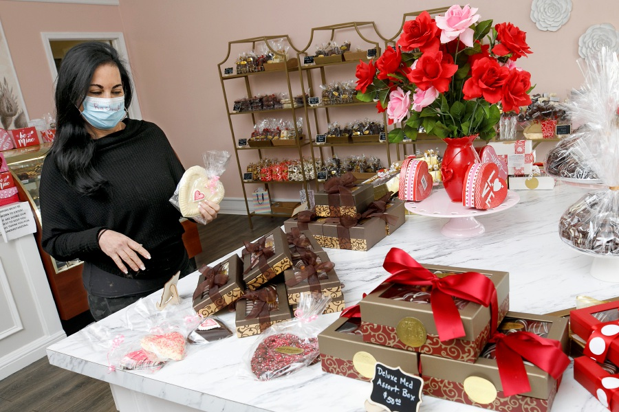 Racheal Ceste, owner of Sweet Cioccolata, shows some of the many Valentine