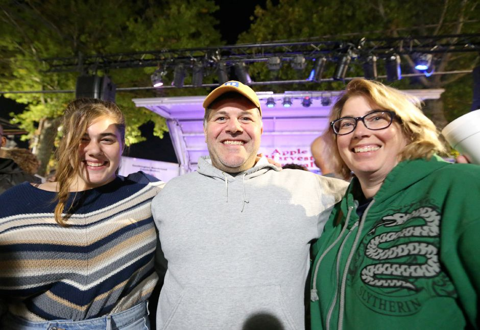 Maya, left, Seth, and Kathy Winkleman in front of the main stage getting ready for the Spin Doctors concert at the annual Apple Harvest Festival in Southington on Saturday, Oct. 12, 2019. Emily J. Tilley, special to the Record-Journal.