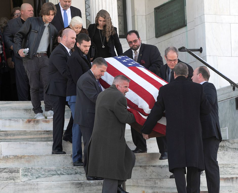 Pallbearers carry the casket of Walter A. Shamock Jr. after a memorial service at the Augusta Curtis Cultural Center in Meriden, Thurs., Dec. 12, 2019. Shamock, a former realtor and Korean War veteran, was a longtime postal worker before he retired and joined the Meriden City Council in 1989. Dave Zajac, Record-Journal