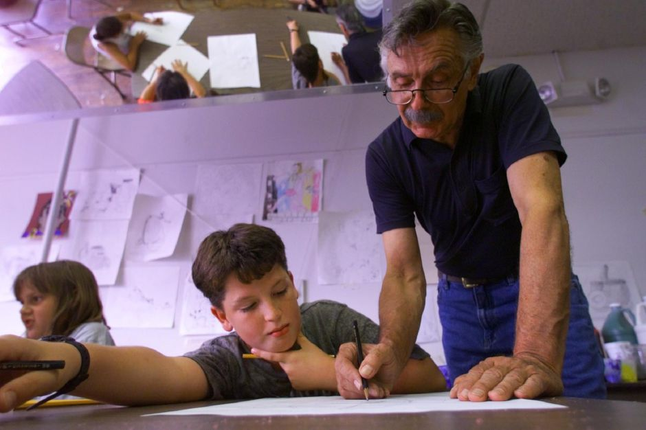 Bruce Raven, gives some drawing tips to Jason Burlison, 12, of Meriden, during a kidz arts camp at Gallery 53 in Meriden Tuesday July 27, 1999. This is Jason