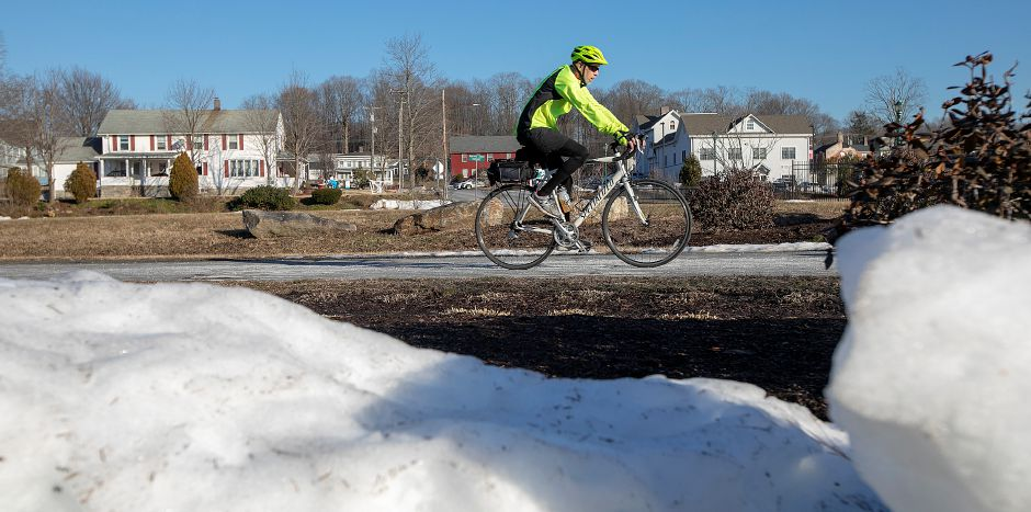 A cyclist rides along the Farmington Canal Heritage Trail on a warm winter afternoon in Southington, Mon., Feb. 4, 2019. Dave Zajac, Record-Journal