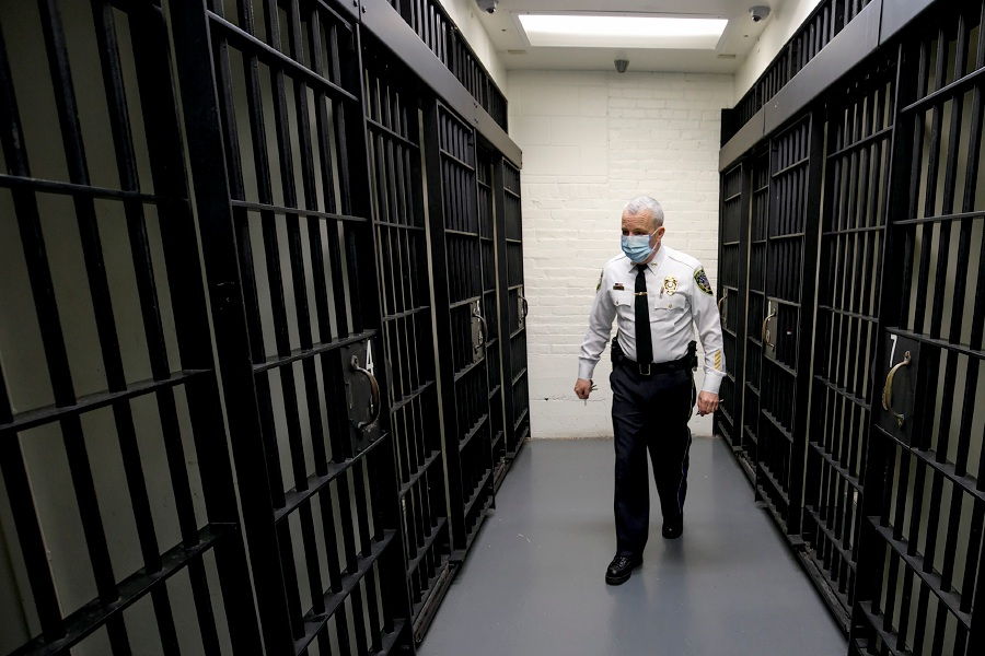 Police Chief William Wright walks through the lockup area of the Wallingford Police Department where 1980s features remain including jail cells that have bar doors rather than solid steel doors, Fri., Apr. 16, 2021. Last week, the Town Council approved spending $3.3 million to purchase 100 Barnes Road for a new police headquarters and a design study. Dave Zajac, Record-Journal