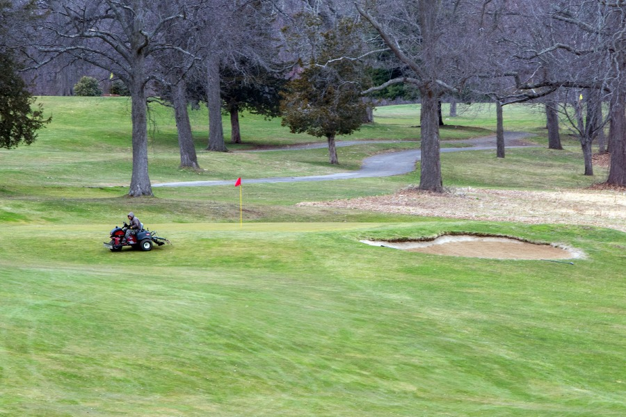 A grounds crew member cleans up around the first hole at Hunter Memorial Golf Course on Wednesday. The state of Connecticut has given golf courses the OK to reopen, which Hunter wil do on Thursday at 8:30 a.m. Aaron Flaum, Record-Journal