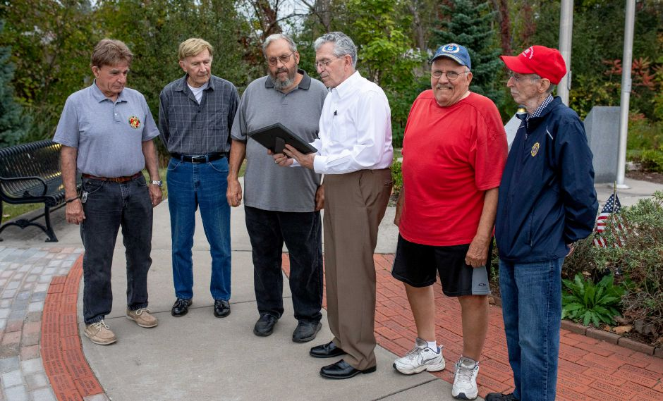 Members of the Berlin Veterans Commission stand with Charles Paonessa, third from left, during a ceremony to thank him and Parks and Grounds Foreman Steve Wood for their support for improvements to Veterans Memorial Park. The ceremony was held at the park on Oct. 7, 2019. | Devin Leith-Yessian/Berlin Citizen