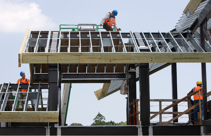 Construction crews work on the roof of the Wallingford train station, Wednesday afternoon, July 6, 2016.  | Dave Zajac, Record-Journal