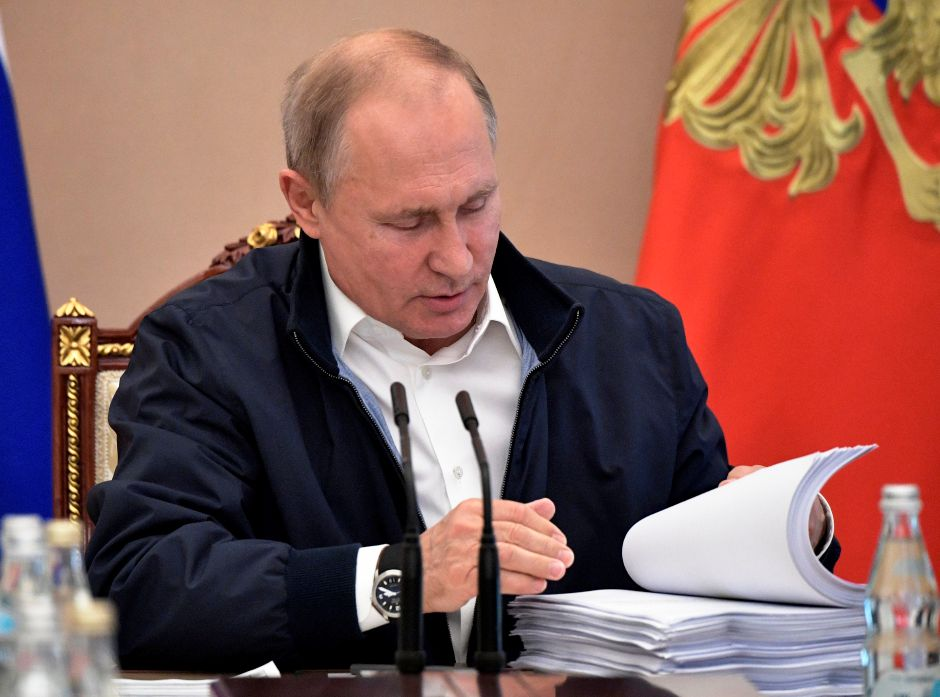 Russian President Vladimir Putin reads documents as he chairs a meeting ahead of his annual question and answer session  June 19, 2019. (Alexei Nikolsky, Sputnik, Kremlin Pool Photo via AP)