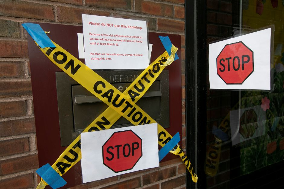 The bookdrop at the Meriden Public Library is closed due to the risk of Coronavirus infection, Thurs., Mar. 19, 2020. The library is asking to keep all items at home until at least March 31. No fines or fees will accrue according to the sign. Dave Zajac, Record-Journal