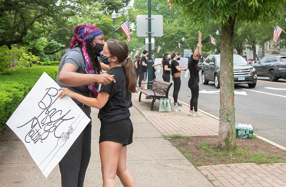 Amy Malachi, of Wallingford, left, is moved to tears as she is hugged by Gabby Ciotto, of Wallingford, during a silent protest in solidarity with the Black Lives Matter movement along South Main Street in Wallingford, Fri., Jun. 5, 2020. Dave Zajac, Record-Journal