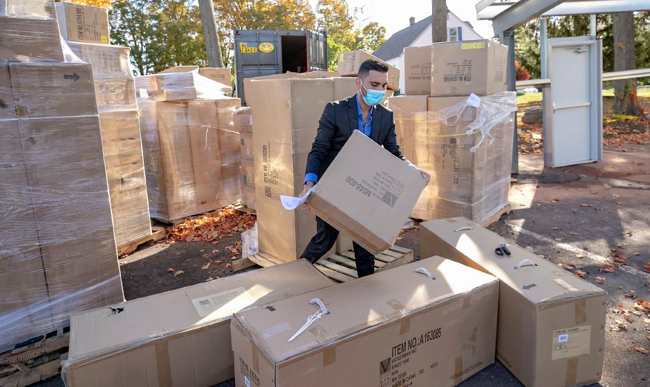 "Tony Papahristou, manager of Cava, stacks boxes full of decorations for ""The Polar Express,"" one of several themes the restaurant is featuring in their annual Christmas Winter Spectacular display, Thurs., Oct. 15, 2020. Dave Zajac, Record-Journal"