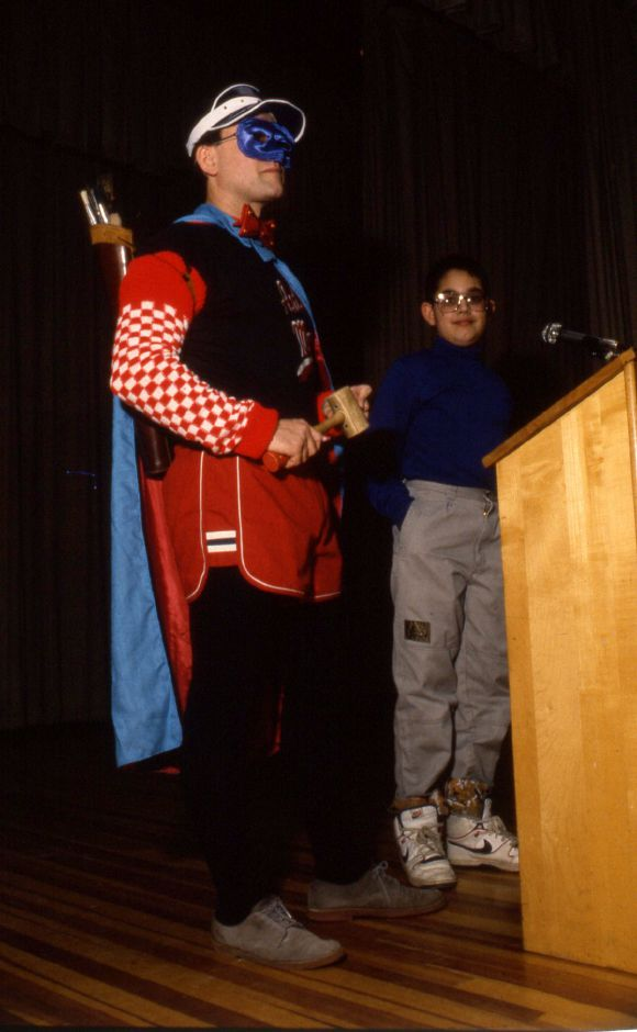 RJ file photo - Ron Gagliardi (the Art Man) and Moses Y. Beach school fifth-grader Michael Mesiya nominate Jim Davis - creator of Garfield - as artist of the year, Jan. 1990.