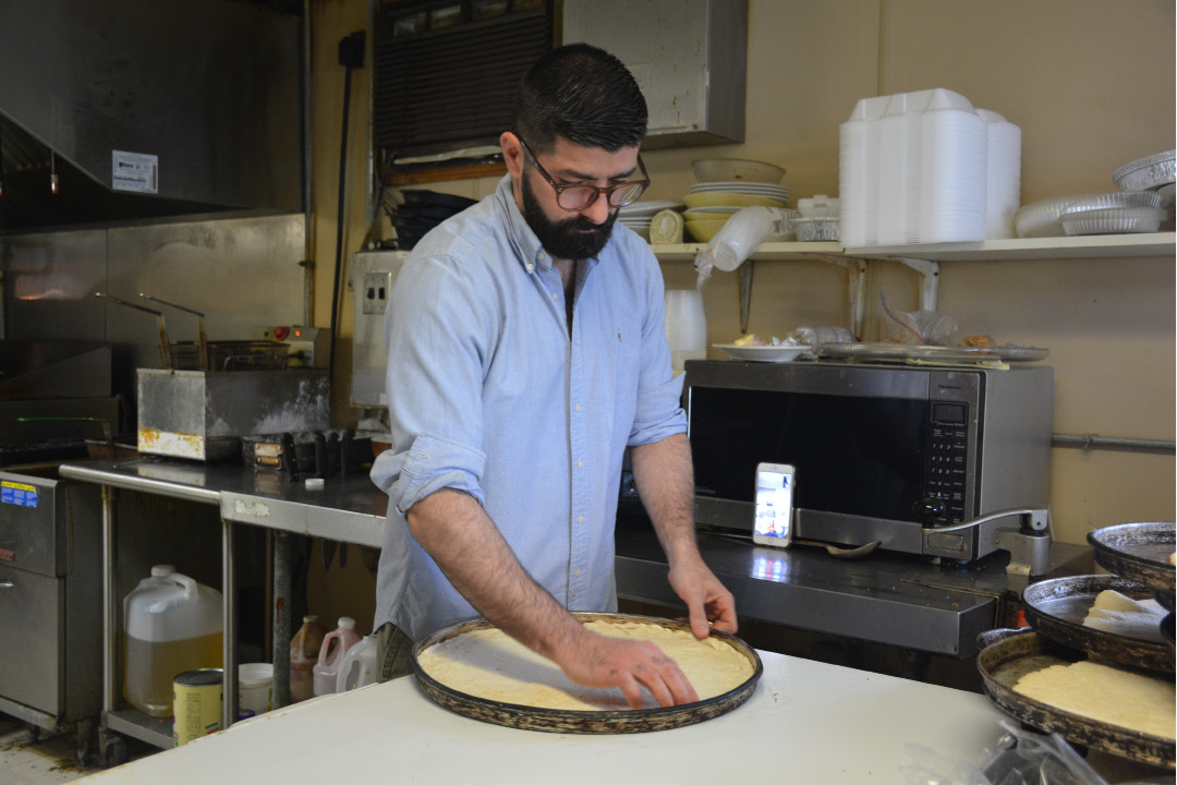 Soon to be owner of Cheshire Pizza, Dimitrios Magriplis, preparing the crust for an upcoming pizza order.  | Ariana D
