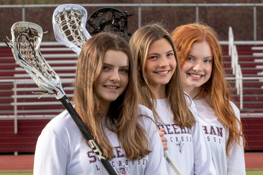 Front to back; Sheehan's Girls Lacrosse players Emma Oliano, Amelia Mansfield and Kylie Allerdice at Sheehan on Wednesday, Dec. 30, 2020. Emma will be attending Eastern Connecticut State University, Amelia will be attending Southern Connecticut State University and Kylie will be attending Western Connecticut State University. Aaron Flaum, Record-Journal