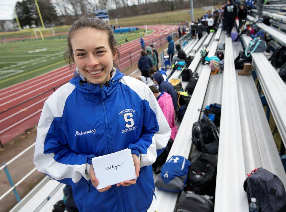 Southington High School student Julia Michnowicz, 16, is selling cards she made to raise money for friend Hannah Sousa