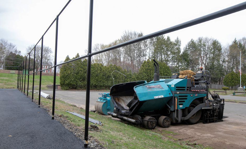Paving equipment is seen here at Cheshire Park on April 23, 2020. The tennis courts have been resurfaced at Cheshire Park.