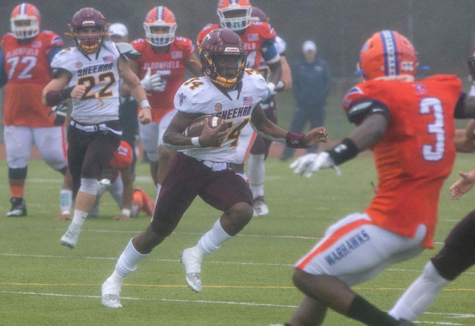 Sheehan's Terrence Bogan runs for yardage against Bloomfield during the CIAC Class S Championship Football game at Trumbull High School. Aaron Flaum, Record-Journal