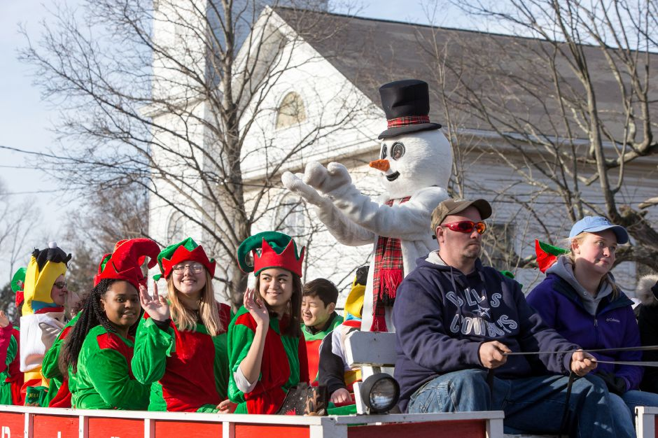 Frosty waves to the crowd Saturday during Christmas in the Village on Main Street in South Meriden December 1, 2018 | Justin Weekes / Special to the Record-Journal