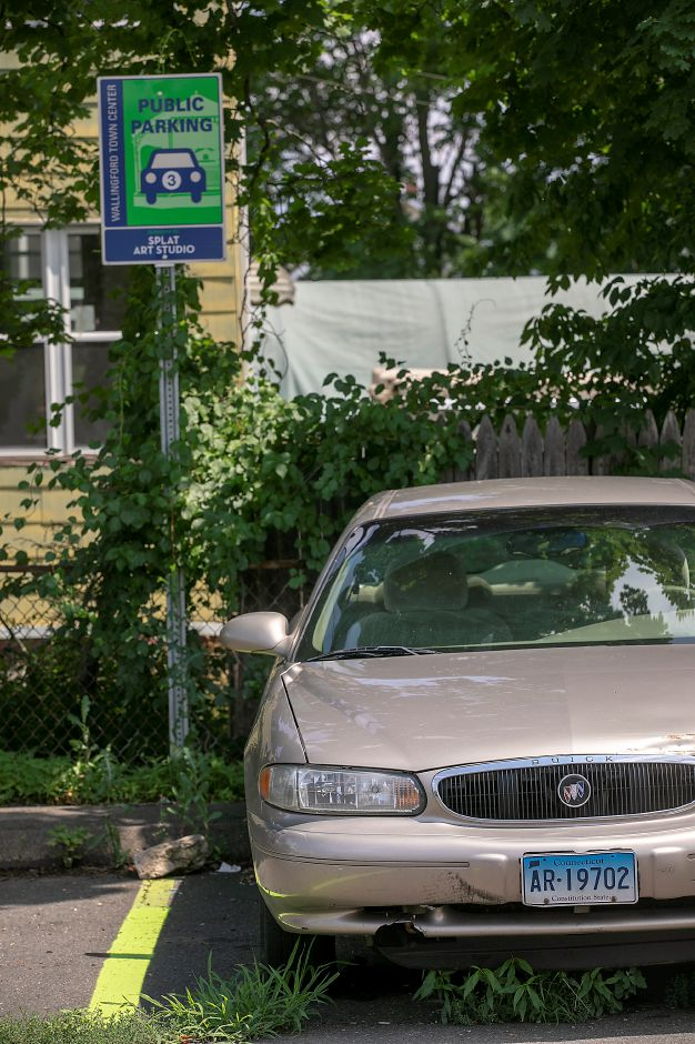 A vehicle parked in Public Lot 3 located between William Street and Meadow Street in Wallingford, Thurs., Jul. 9, 2020. Several town officials are considering new parking rules aimed at discouraging long-term parking. Dave Zajac, Record-Journal
