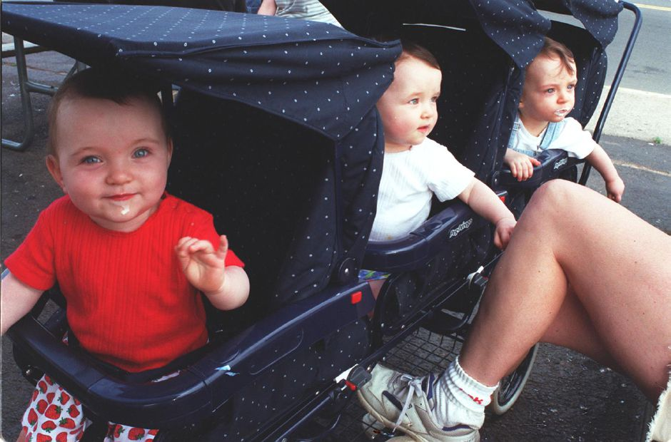 The Sullivan triplets of Wallingford, Callie (front), Kate (center), and Mack, await spoonfuls of ice cream outside the Dairy Queen on Route 5 in Wallingford Monday afternoon June 19, 2000. The Triplets will turn 1 year old this Thursday.