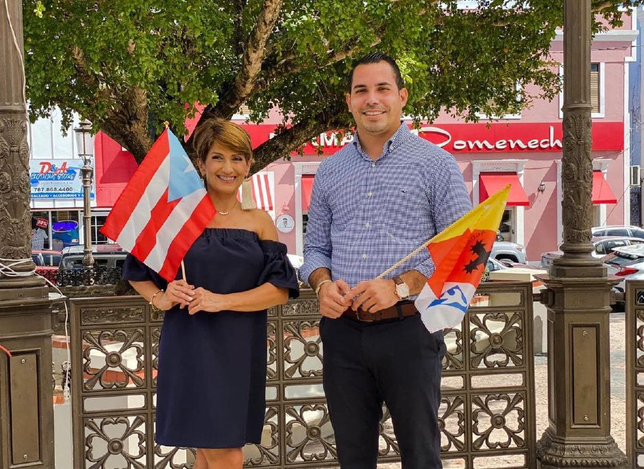 Daisy Cardona and Christian Cortes-Feliciano in Aguada holding up the Puerto Rico  and Aguada flags. Submitted photo