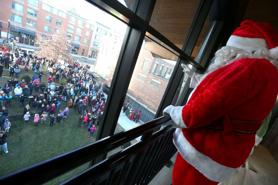 Santa waves to the crowd of people anxiously waiting to see him outside of the train station in Meriden during the annual Yulefest in Meriden on Saturday, Nov. 30, 2019. Emily J. Tilley, special to the Record-Journal.