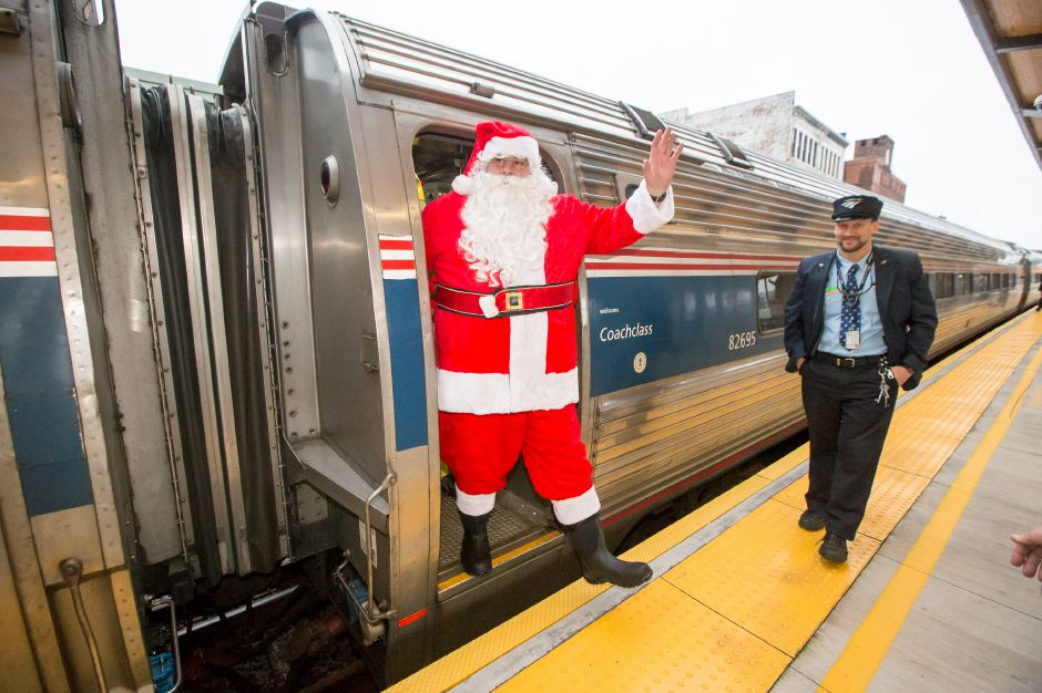 Santa arravies on an Amtrak train at the Meriden Train Station Saturday during the YuleFest Meriden and Holiday Market Place on Colony Street in Meriden November 24, 2018 | Justin Weekes / Special to the Record-Journal