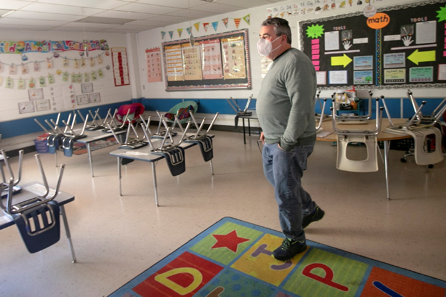 Dan Coffey, principal of Casimir Pulaski Elementary School in Meriden, makes the rounds through empty classrooms, Tues., May 5, 2020, after Gov. Ned Lamont closed schools for the rest of the academic year due to the coronavirus pandemic. | File photo.