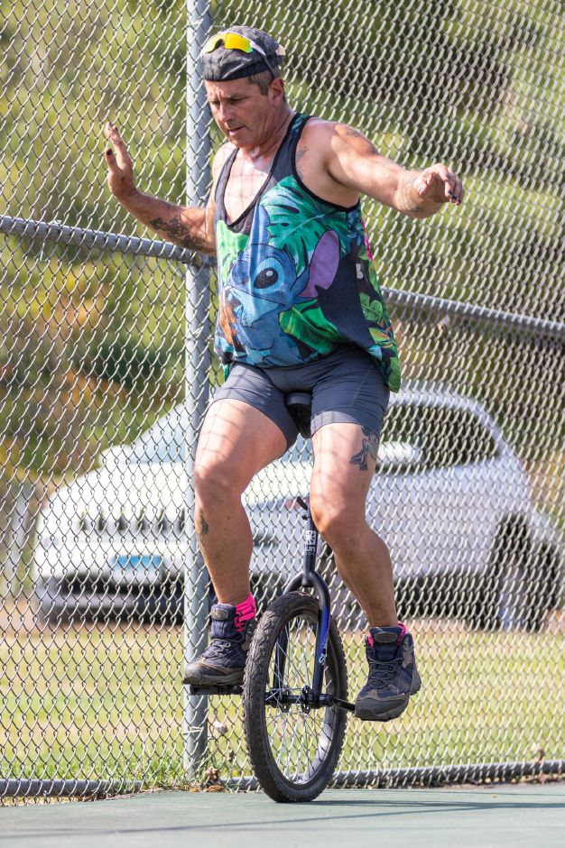 Wolfie Ventriglia, of Wallingford, works on learning to ride a unicycle on the tennis courts at Community Lake Park in Wallingford on Friday. Wolfie is learning to ride the unicycle to be part of his character for the upcoming Trails of Terror in Wallingford that opens on Oct. 2.