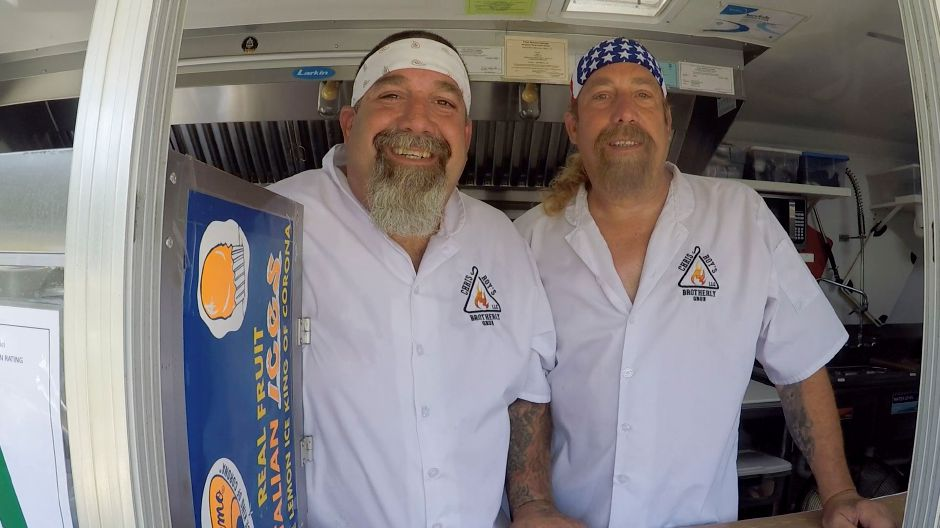 Chris and Roy Metzger pose for a photo inside their food truck, Chris and Roy's Brotherly Grub, stationed in Meriden on Wednesday. Photos by Bailey Wright, Record-Journal