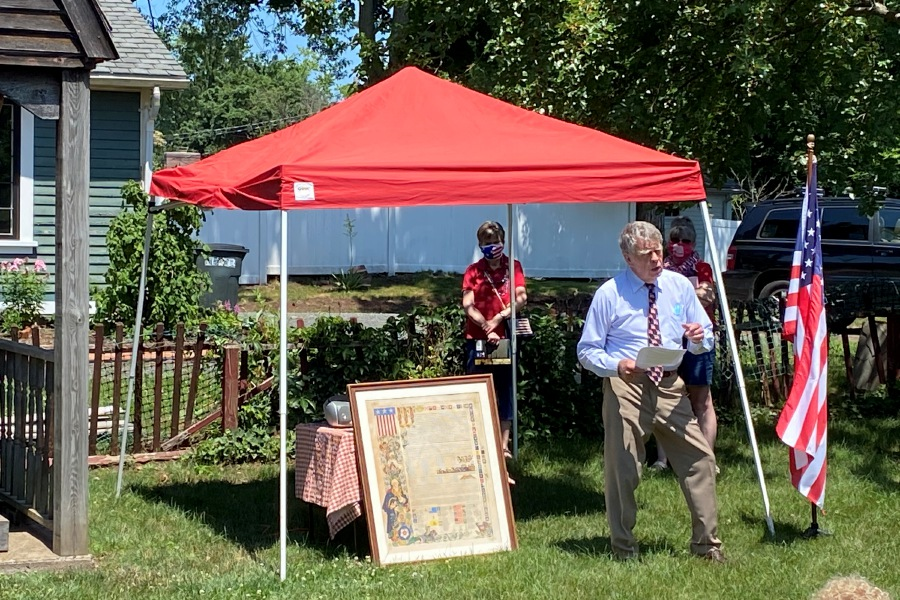 Wallingford Historical Society member Bob Beaumont speaks at the annual bell ringing at the Wallingford Historical Society on Saturday afternoon. | Sean Krofssik, Record-Journal