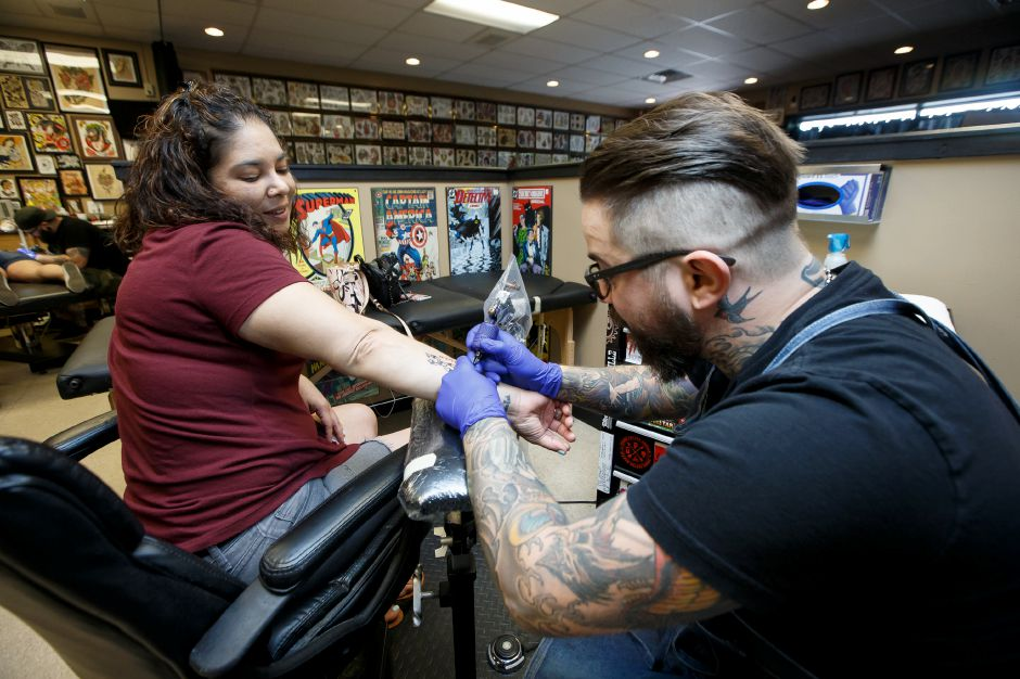 Nirah Ocasio of West Haven is tattooed by Jay Phoenix  during a Sunday fund-raiser at Phoenix Ink Tattoo in Plantsville for the Connecticut Alliance to End Sexual Violence.