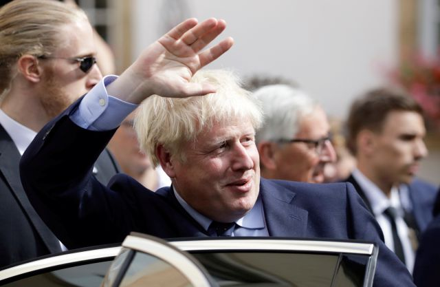 British Prime Minister Boris Johnson, center, waves as he departs after a meeting with European Commission President Jean-Claude Juncker in Luxembourg, Monday, Sept. 16, 2019. British Prime Minister Boris Johnson held his first meeting with European Commission President Jean-Claude Juncker on Monday in search of a longshot Brexit deal. (AP Photo/Olivier Matthys)